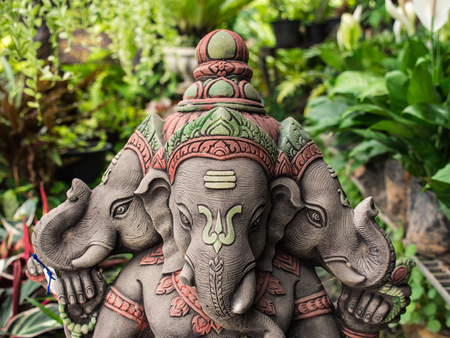 Three Headed Deity Ganesh Statue, Standing In The Garden Stock Photo,  Picture And Royalty Free Image. Image 84600366.