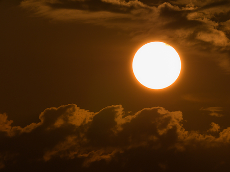 The Sun is Close to The Clouds in The Yellow Background