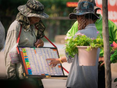 Garden Worker is Choosing The Lottery Salesman