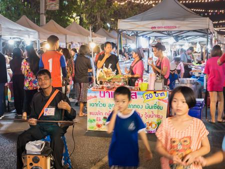 11 March'18 SroewGround Walking Street Buriram Province Thailand : The Blind Man Played Ancient Music in The Night Maket