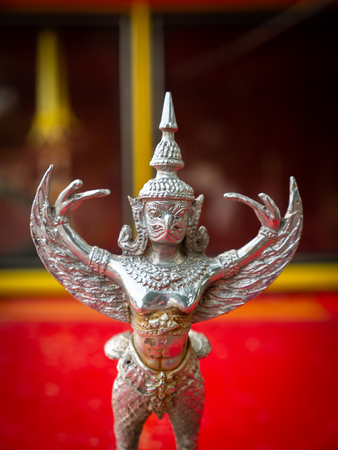 The Silver Garuda Standing in The Red Bus