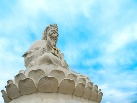 The White Statue of Guanyin Sitting on The Lotus