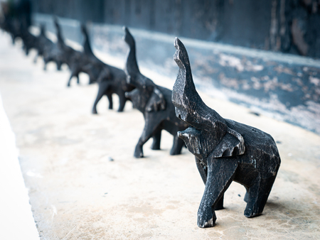 The Carved Wooden Black Elephants Standing in a Row on The Floor Imagens