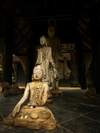 The Buddha Wood Carve Sitting and Standing in The Pavilion Imagens