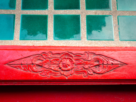 The Flower Shape Carved on The Red Sill in The Church