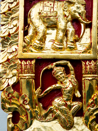 The Golden Fairy and Elephant Sculpture in Red Background at The Wall of Temple Imagens