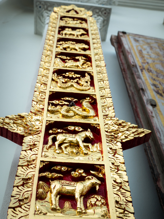 The Golden Constellation Sculpture in Red Background at The Wall of Temple