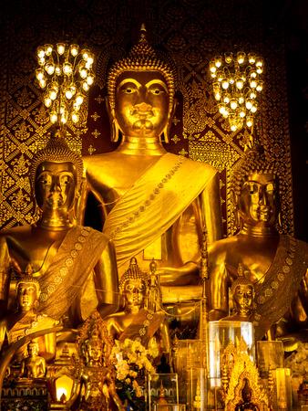 The Golden Buddha  Statues Arranging Peacefully in The Church , Wat Chai Lanphun Thailand