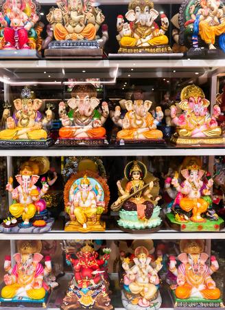 The Statue of Ganesha and Sarasvati Goddess in The Sitting Posture in The Mirror