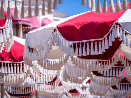 The Large Red White Umberllas with Festoons Stacking in The Park
