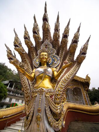 The Golden Statue of The Angel in The Nine Headed Serpent in The Temple Фото со стока
