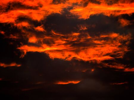 The Patterned Golden Yellow Mixed with Red Scary Clouds in The Morning