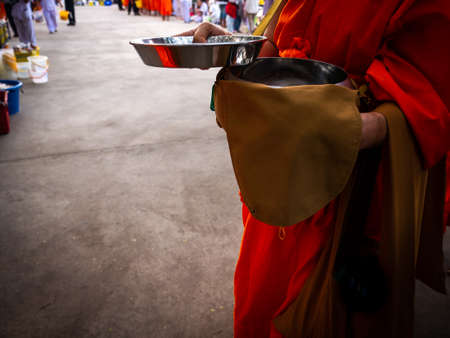 The Monk Holding The Lid of Almsbowl in The Big Merit-making Day Stock Photo