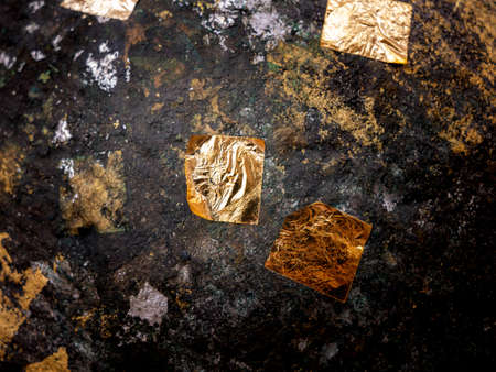 The Gold Leaves on The Old Ancient Stone in front of The Church Foto de archivo