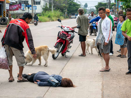 11 Nov'20 Surin Province Thailand : The Young Woman was in an Accident Lying on The Street and The People around Her Editorial