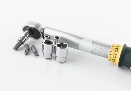 Preset Torque Wrench Ratchet on white background photo