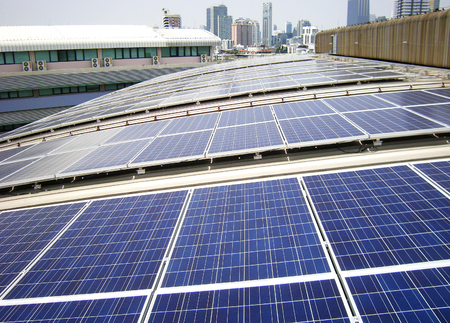 electric cell: Rooftop Solar Panels on Factory Roof Stock Photo