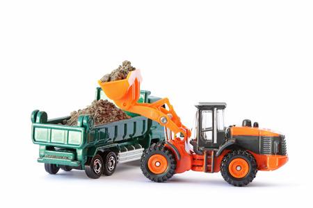 wheel loader: Wheel Loader Loading Soil on Dump Truck