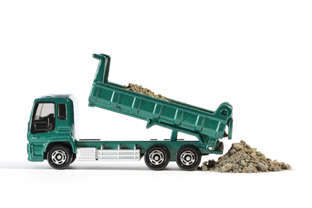 unloading: Dump Truck Unloading Soil Stock Photo