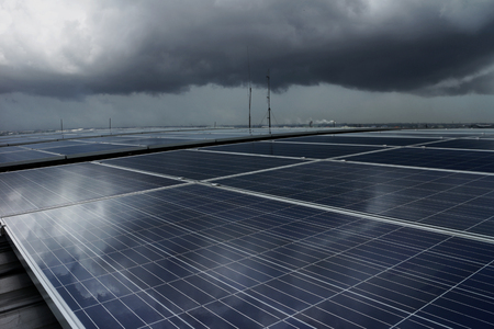 pv: Solar PV Rooftop under Storm Cloud