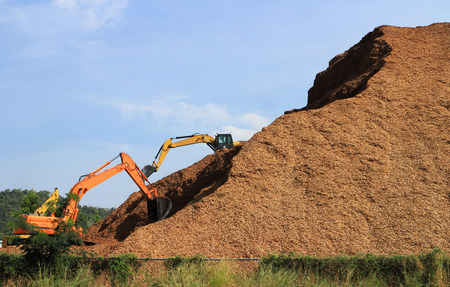 Woodchip Mountain with Backhoes working