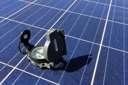 Compass on Solar Panel Importance of Direction Concept Stockfoto