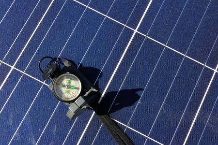 Compass on Solar Panel Importance of Direction Concept Stock Photo