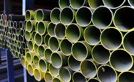 Round Steel Pipes on Shelf