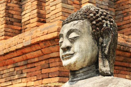 Stone Buddha Statue Red Brick Background 스톡 콘텐츠 - 101493702