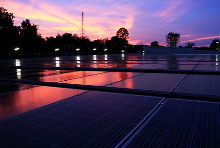 Solar PV Rooftop at Dawn Red Cloud Sky Stock Photo