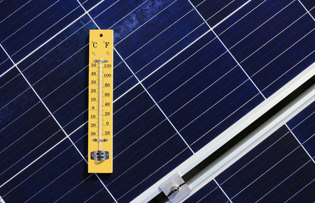 Thermometer on Solar Panel Heat Effect Concept