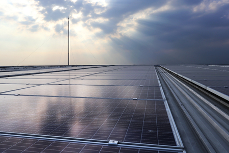 Solar PV Rooftop under Cloud with Sunlight Beam 스톡 콘텐츠