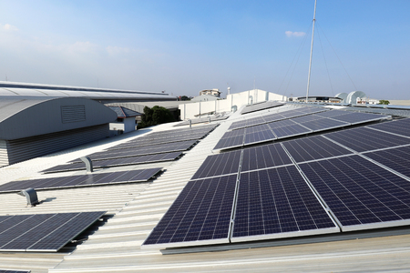 Solar PV on Industrial Roof with Exhaust Duct Chimneys Stockfoto