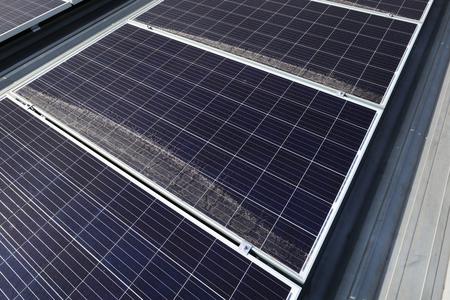 Dirty Dusty Photovoltaic Panels on Roof 스톡 콘텐츠
