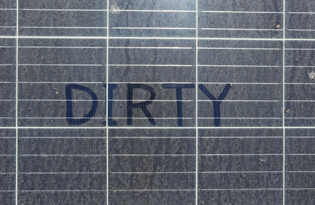 Dirty Dusty Solar Panels with Text DIRTY top view