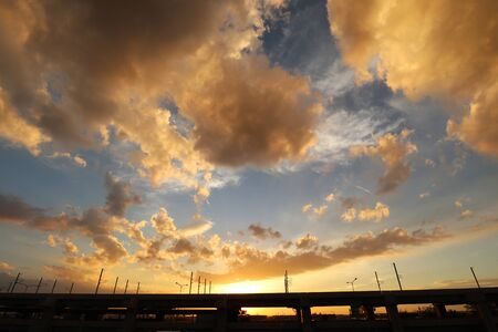 Highway Sunset Scenery with Amazing Colorful Cloudy Skyline 스톡 콘텐츠