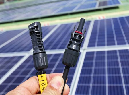 Solar PV Connectors Male and Female Hand Holding 스톡 콘텐츠