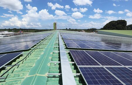 Solar PV Rooftop System with Facility Cloudy Sky Background 스톡 콘텐츠