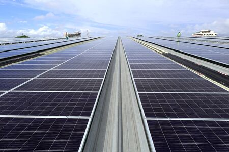 Solar PV Rooftop System Sky Background View with technician walking