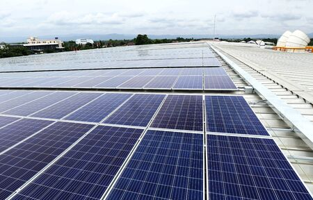 Solar PV on Industrial Roof with Cooling Tower Background