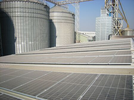 Dusty Solar Panel with Silo Background 免版税图像