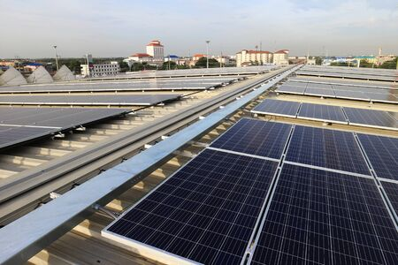 Solar PV Rooftop with Cable Raceway City Background 스톡 콘텐츠