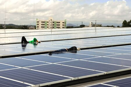 Technicians Arranging Cable Solar Rooftop System 스톡 콘텐츠
