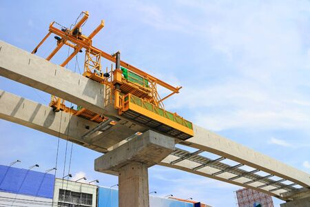 Mobile Hoist Machine working on The Concrete Beams for Sky Train under Construction
