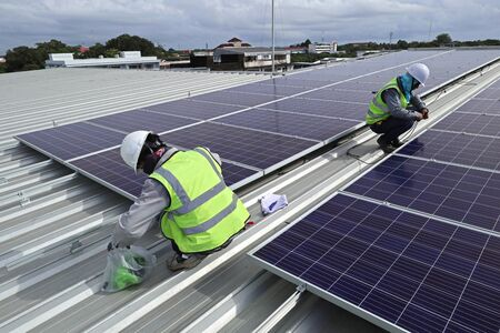 Technician Connecting Cable of Solar Rooftop