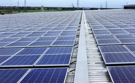 Big Warehouse Roof Covered with Solar Panels 스톡 콘텐츠