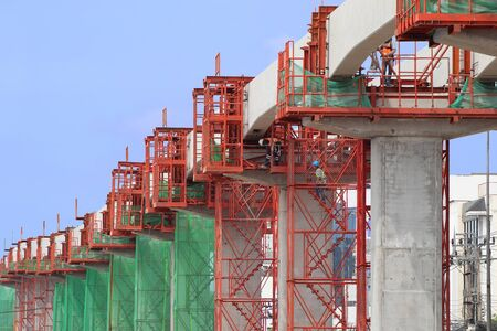 Workers Installing Alignment Tools for Concrete Beams of Sky Train Railway