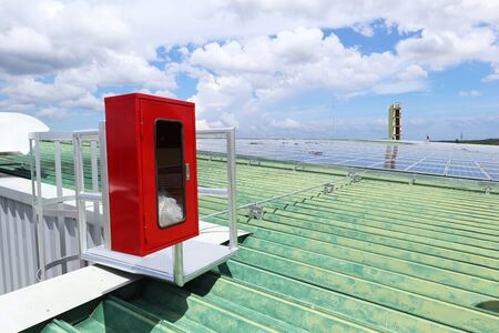 Fire Extinguisher Cabinet of Solar Rooftop System 免版税图像