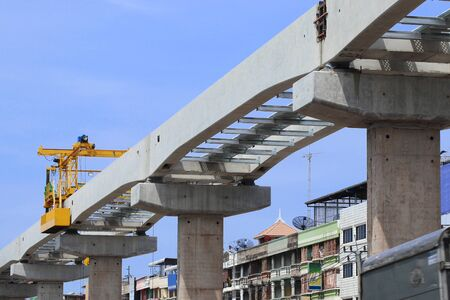 Concrete Beams and columns for Railway of Sky Train under Construction with Mobile Hoist Working on