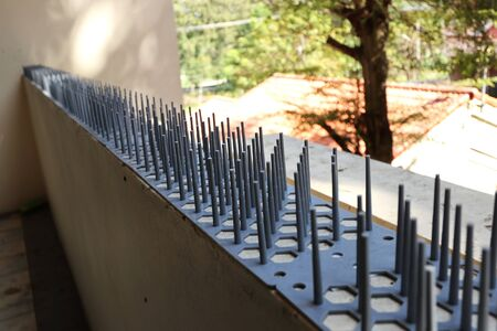 Bird Spikes Installed on Apartment Balcony 스톡 콘텐츠